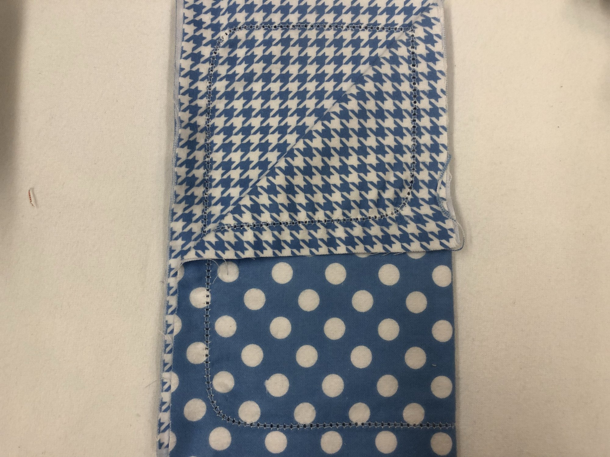 White dots on blue background/Blue and white houndstooth burp