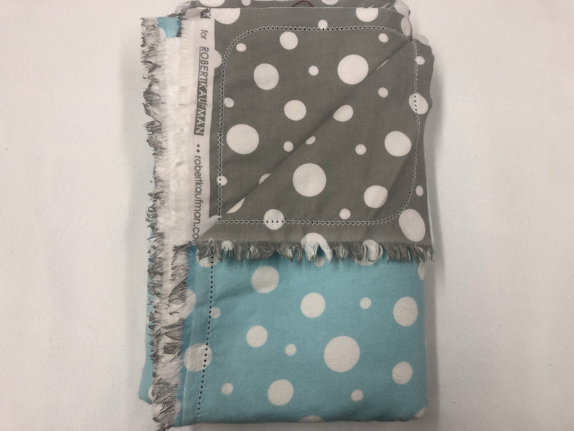 White dots on blue background/White dots on grey background