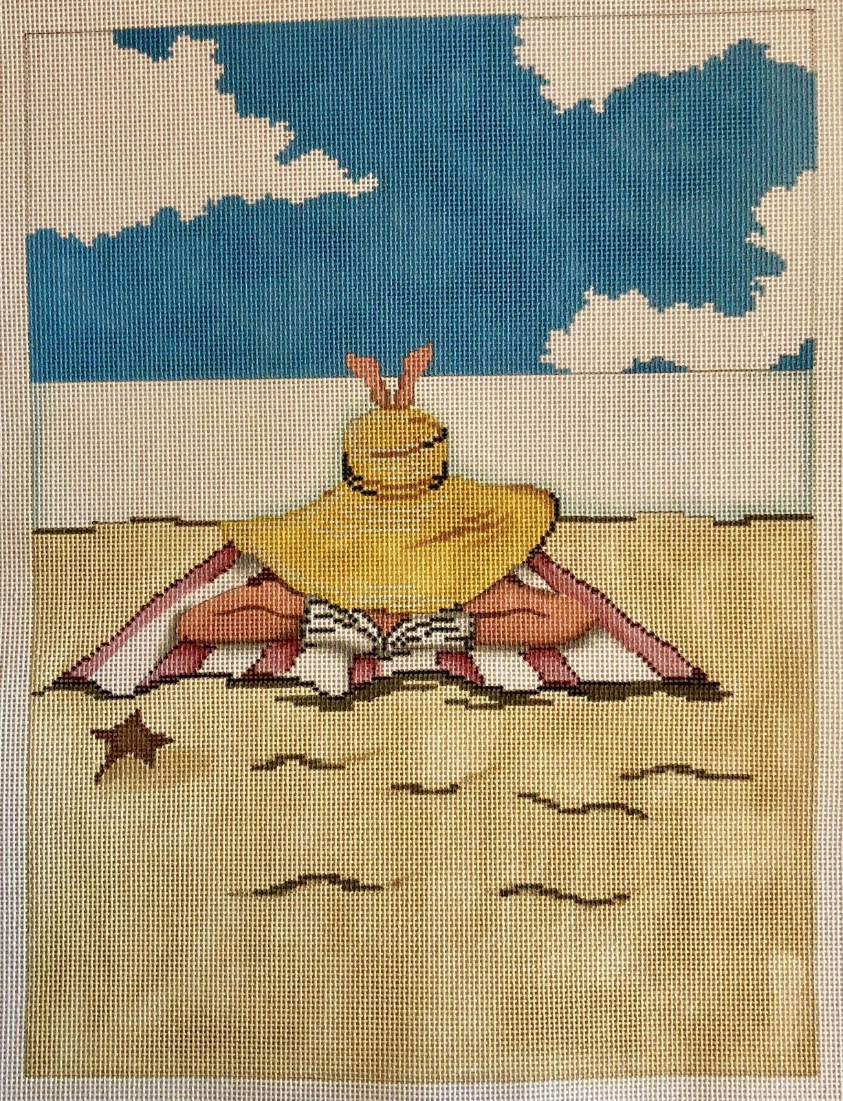 lady on beach towel reading