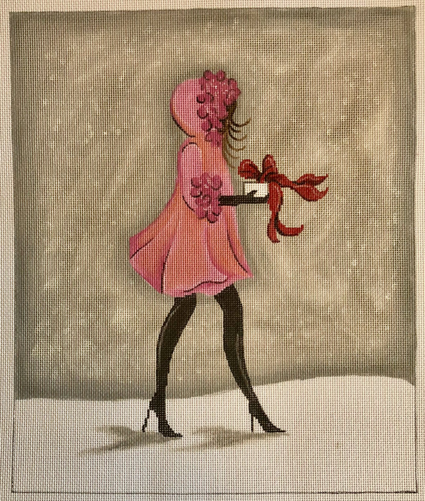 lady in pink coat w gift