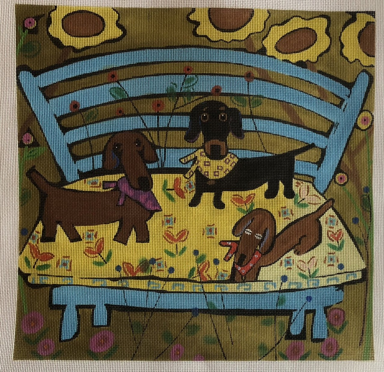 three dogs on blue chair
