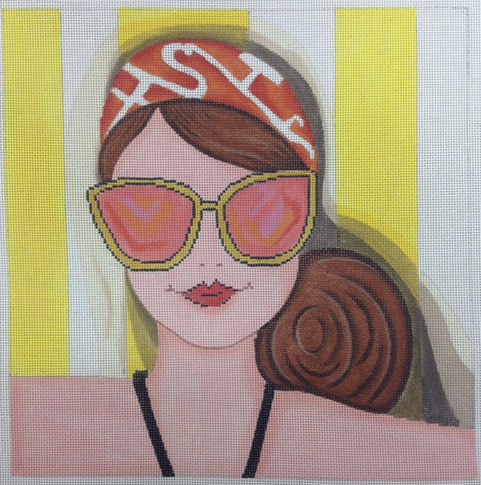 lady in sunglasses on towel