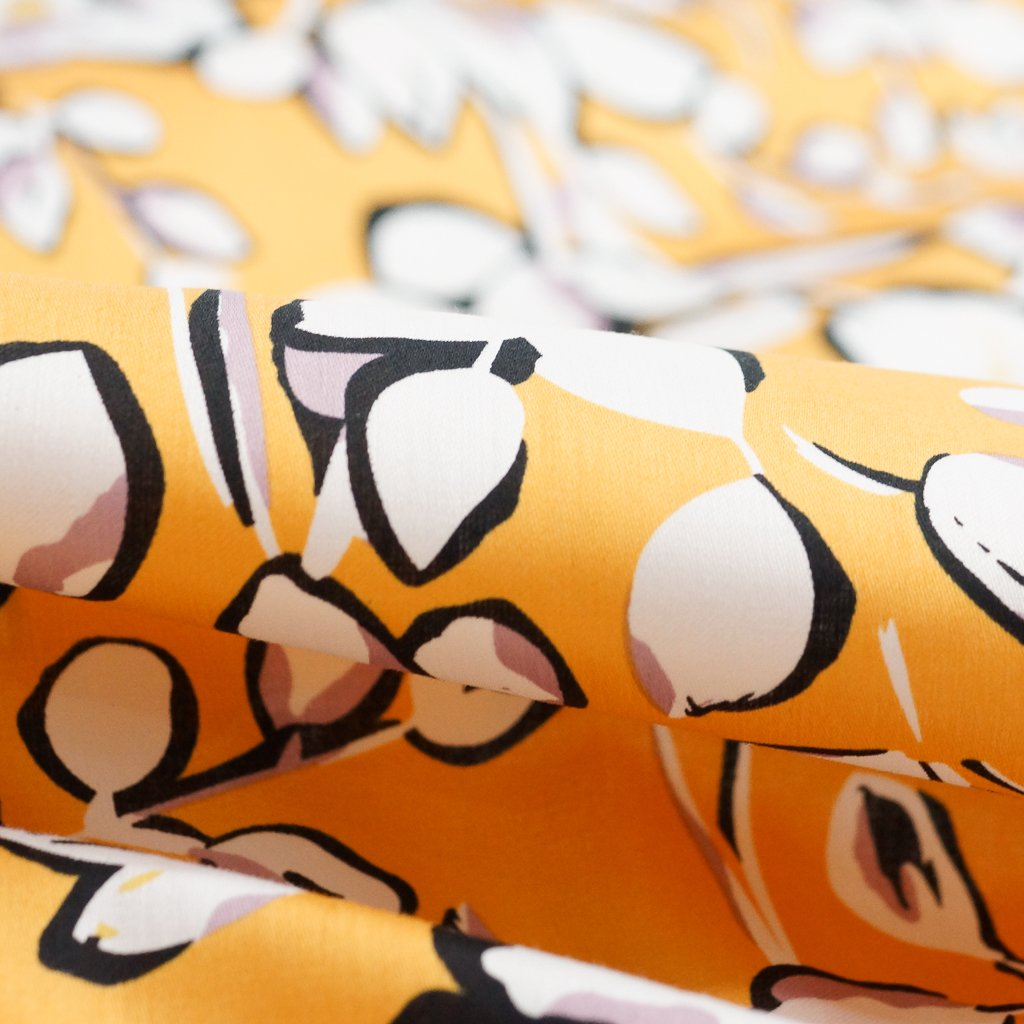 Cotton - Poplin in Tangerine-Yellow, Black, White and Mauve Floral
