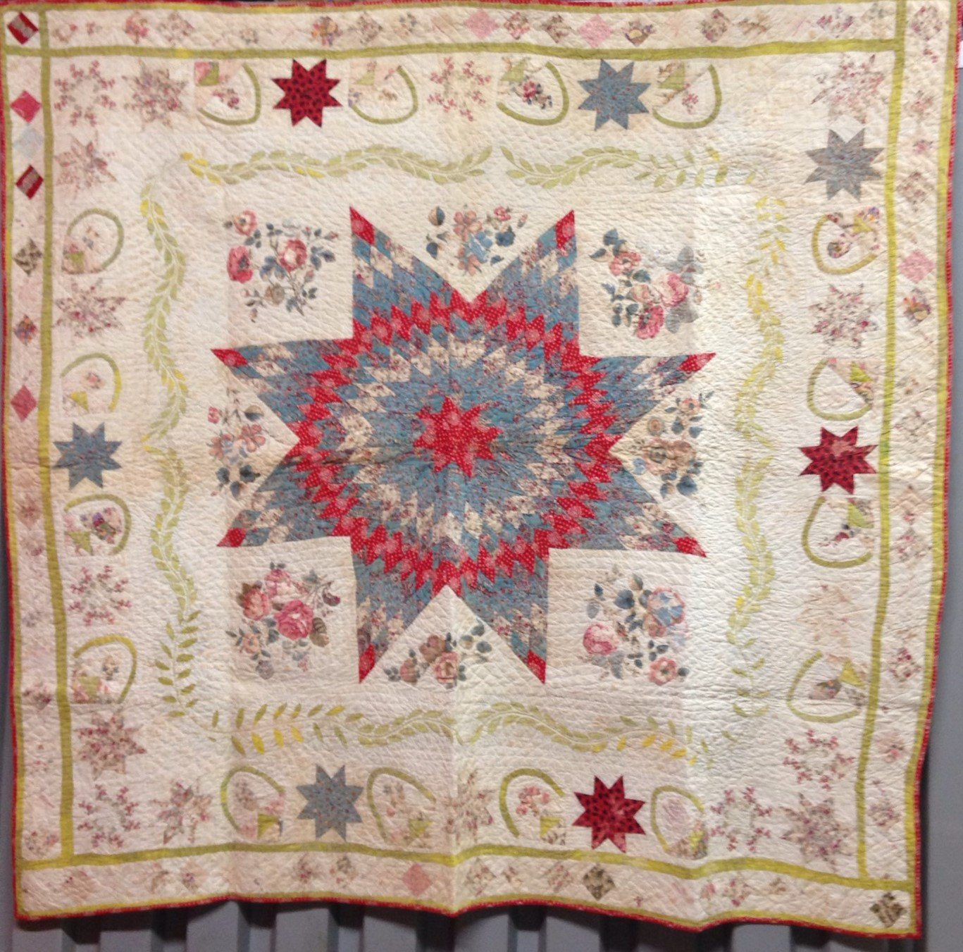 PETITE EIGHT POINT STAR WITH MANY MOTIFS IN BORDERS ANTIQUE QUILT