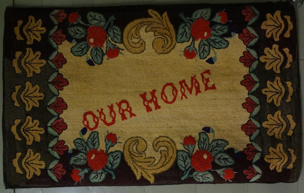 OUR HOME ANTIQUE HOOKED RUG