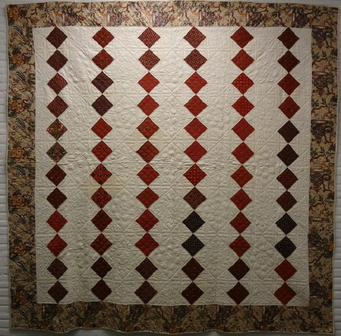 FOUR PATCH DIAMOND ANTIQUE QUILT, Chintz border, reds and white