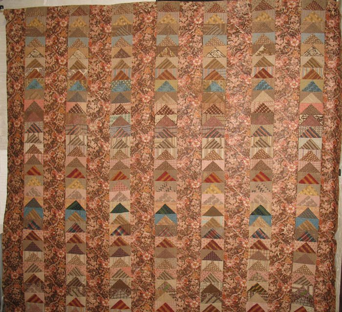 FLYING GEESE AND CHINTZ PIECED BARS ANTIQUE QUILT