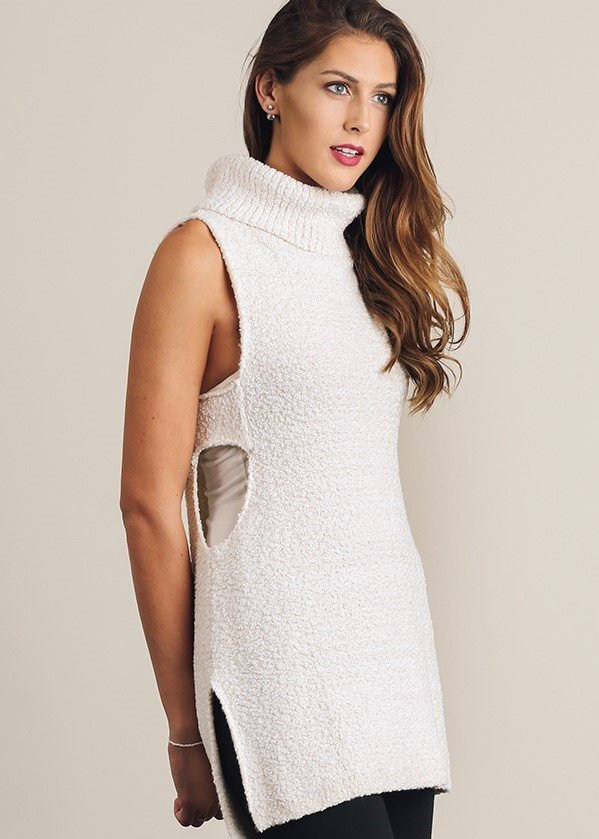 Sleeveless high low turtleneck sweater side slits