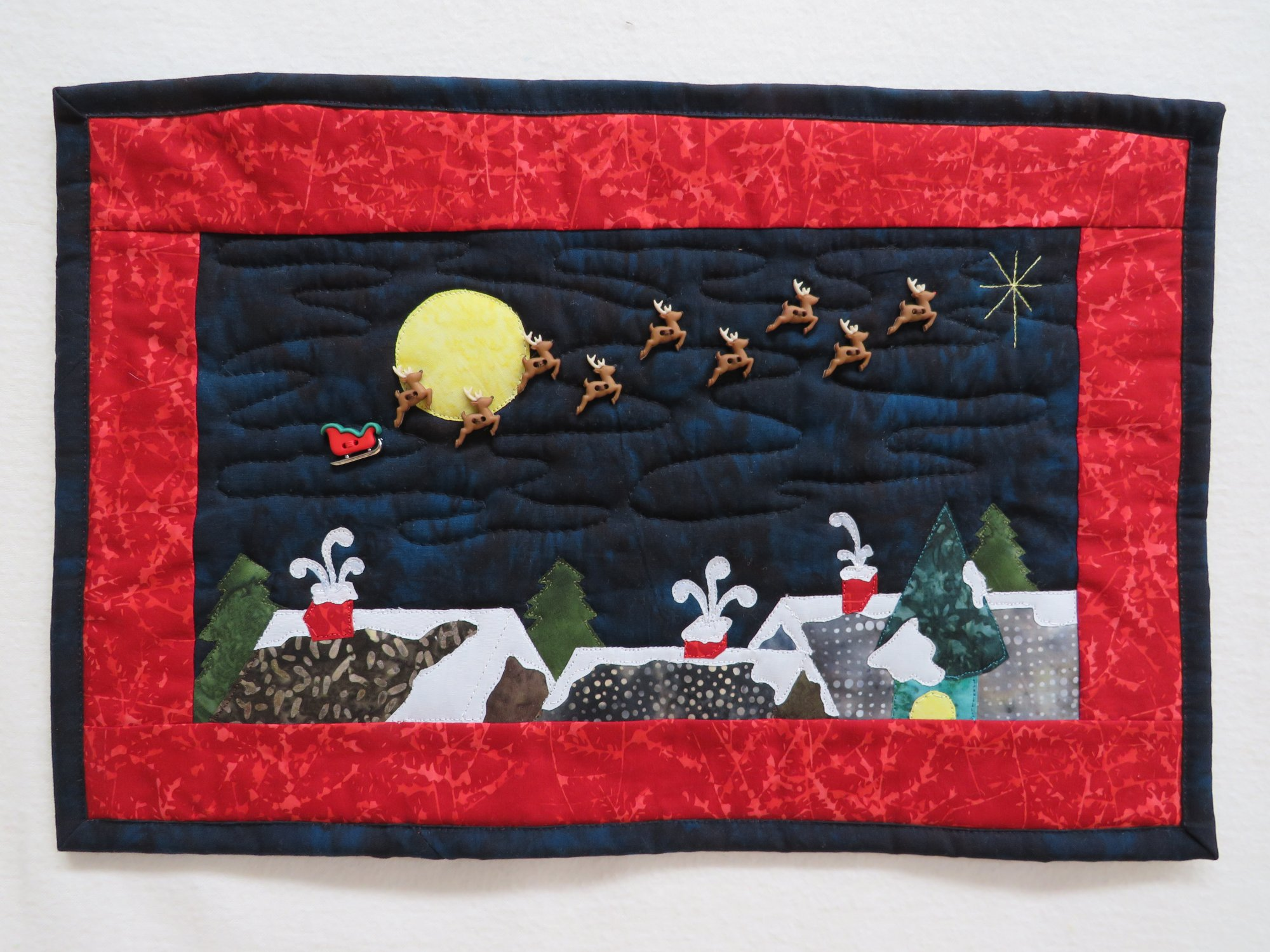 Over the Roof Tops Wall Hanging Kit 16 1/2 x 11 includes Fabric, Sew Cut Sleigh/Reindeer buttons pattern & binding