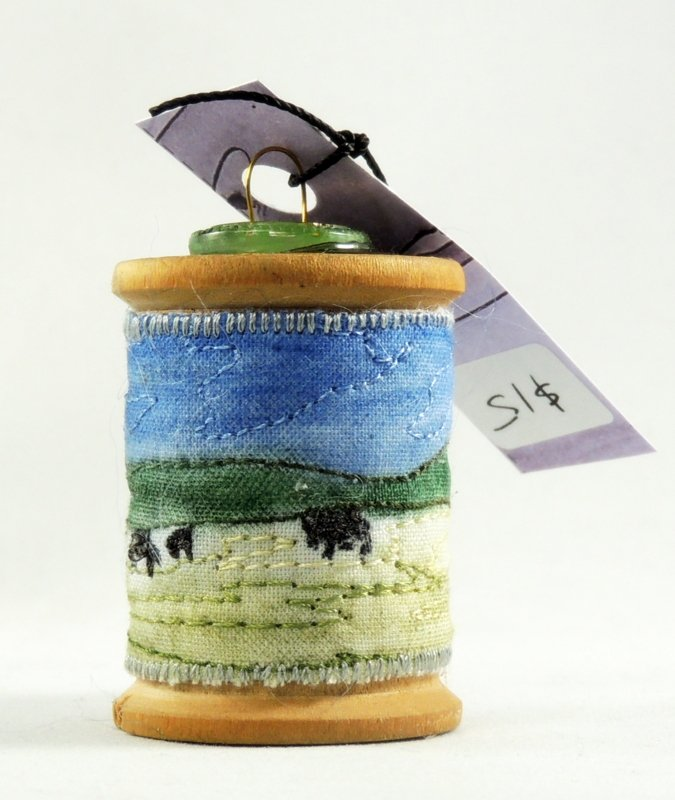 Cows in the fieldThread Painted Wooden Spool Ornament