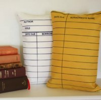 Former librarians and book lovers all over will love these library card pillows.