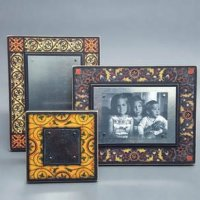 Picture this - handmade frames from Wisconsin that stand or hang, horizontally or vertically and make changing pictures a snap with small earth magnets. Great designs for any occasion at 16 Hands Ann Arbor.