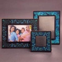 Frames make great gifts. These are from Wisconsin and hold your photos with strong earth magnets. Frames are made to hang of stand on a surface. See all the designs at 16 Hands Ann Arbor.
