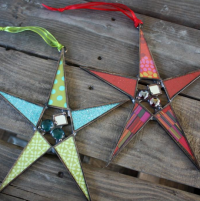 Star ornaments that go well beyond the holiday season. These colorful pieces look great in front of a window all year long. See our current selection at 16 Hands Ann Arbor.