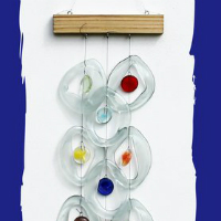 Glass wind chimes made from recycled glass bottles by Bottle Benders. See single and multiple chime designs at 16 Hands Ann Arbor.