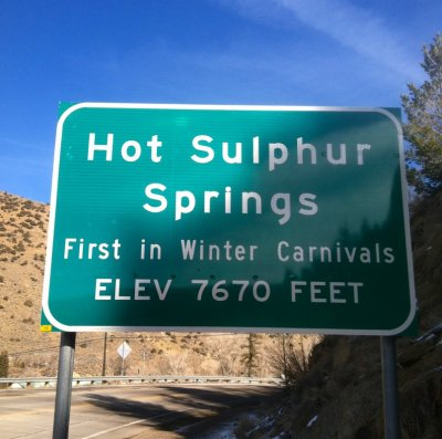 "Hot Sulphur Springs ""First in Winter Carnivals"" signage"