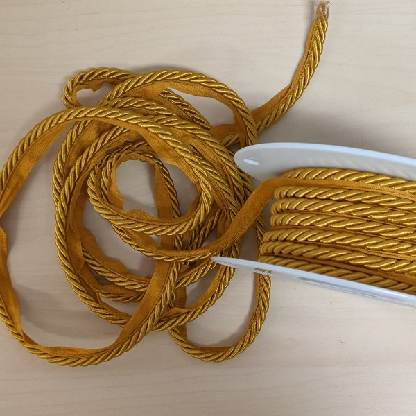 Upholstery Cord - 1/4 Twisted Rope with 3/8 Twill Tape Flange