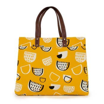 A bright golden bag with a print of happy black and white semi-circles