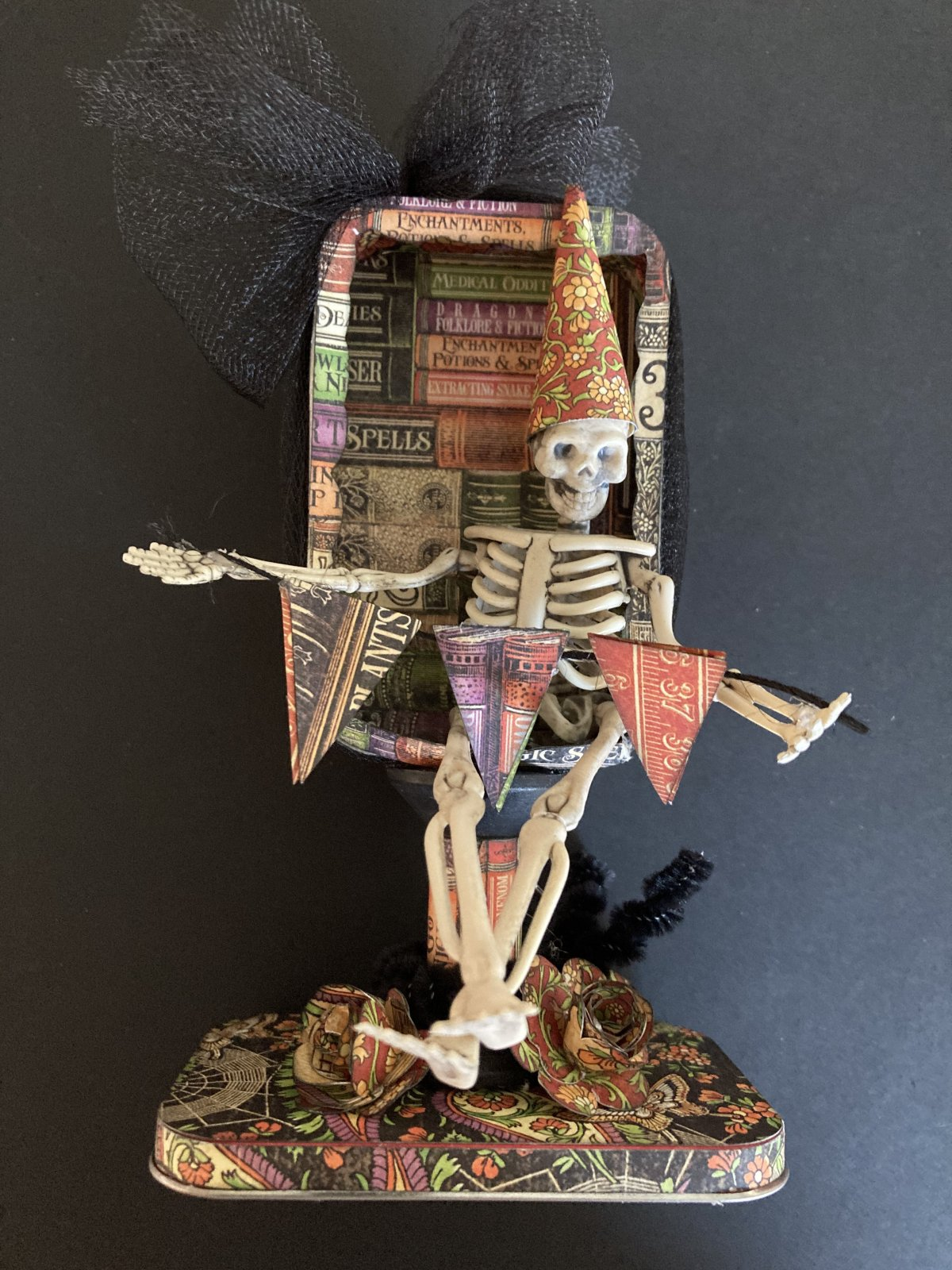 Altered Halloween tin with skeleton