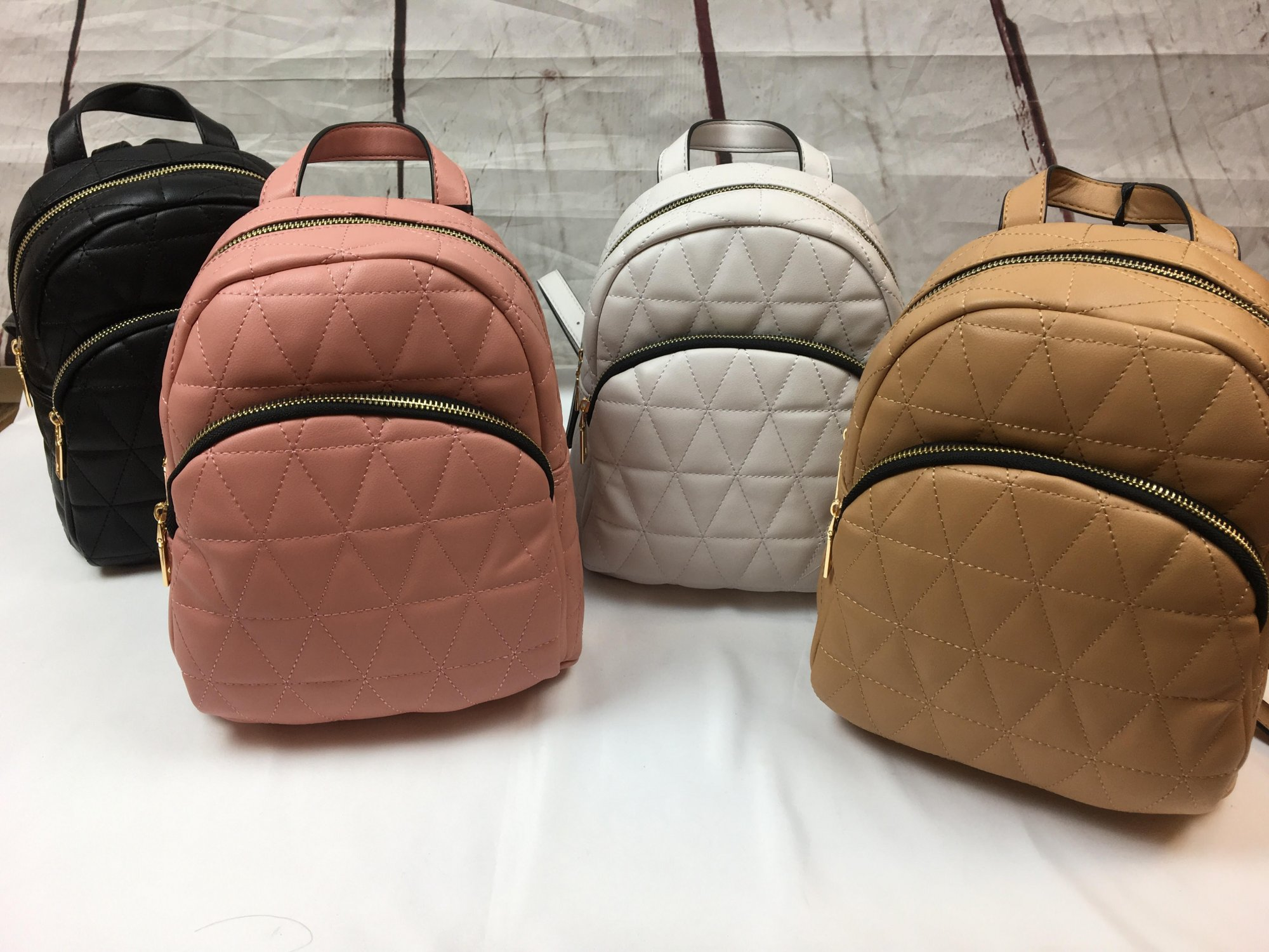 Mini quilted back pack