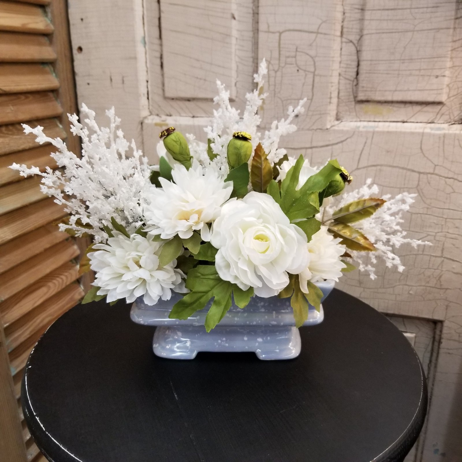 White Floral in Blue Planter