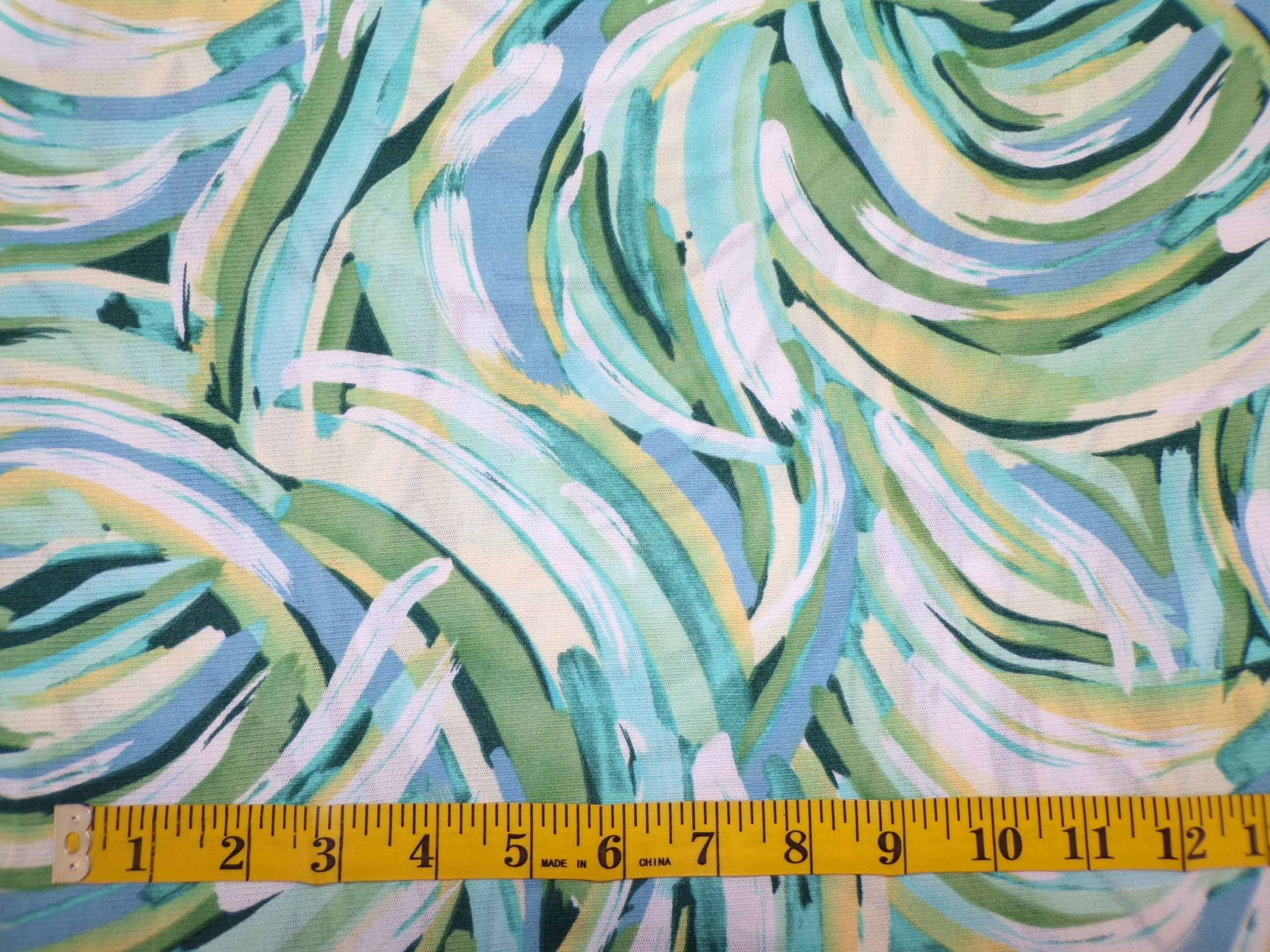 Stretch Mesh -Blue, Green, and Yellow Swirls