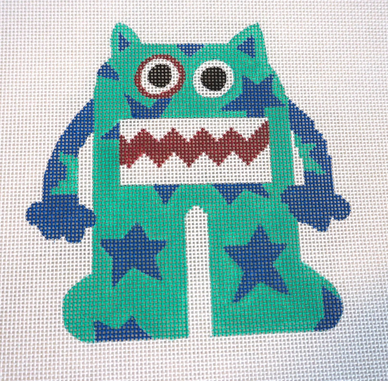 Turquoise Monster with Stars Needlepoint