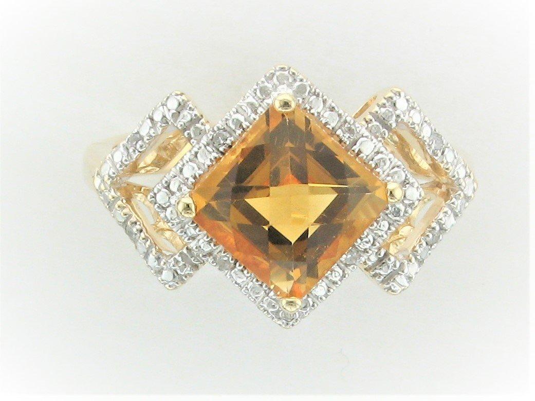 Citrine and Diamond Ring set in 14 Karat Yellow Gold