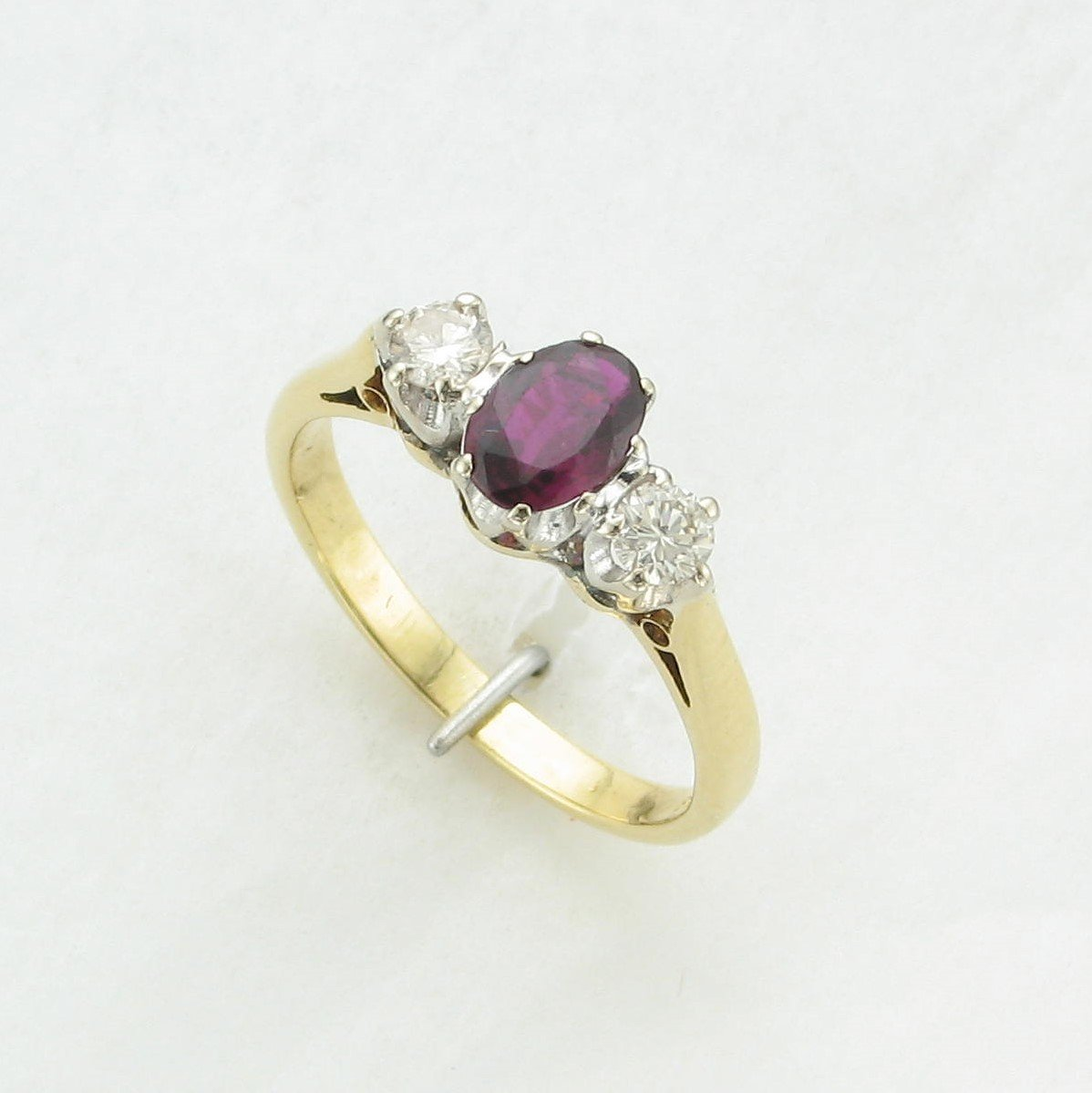 0.60ct Oval Ruby and Diamond Ring set in 18K Yellow Gold