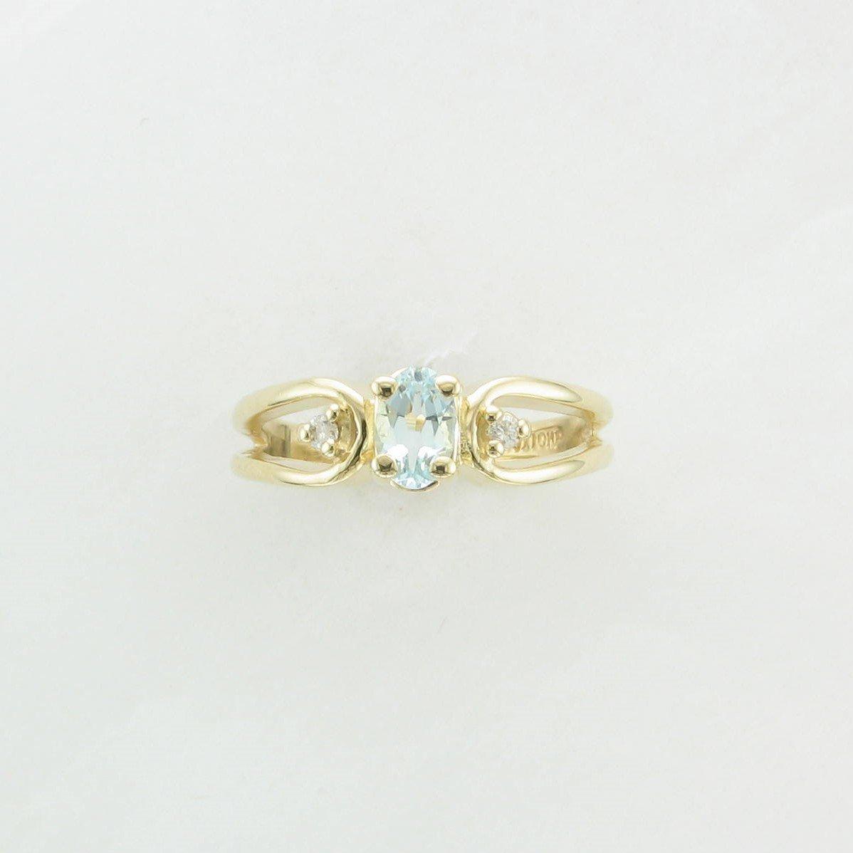 0.60ct Oval Aquamarine & Diamond Ring set in 10k Yellow Gold