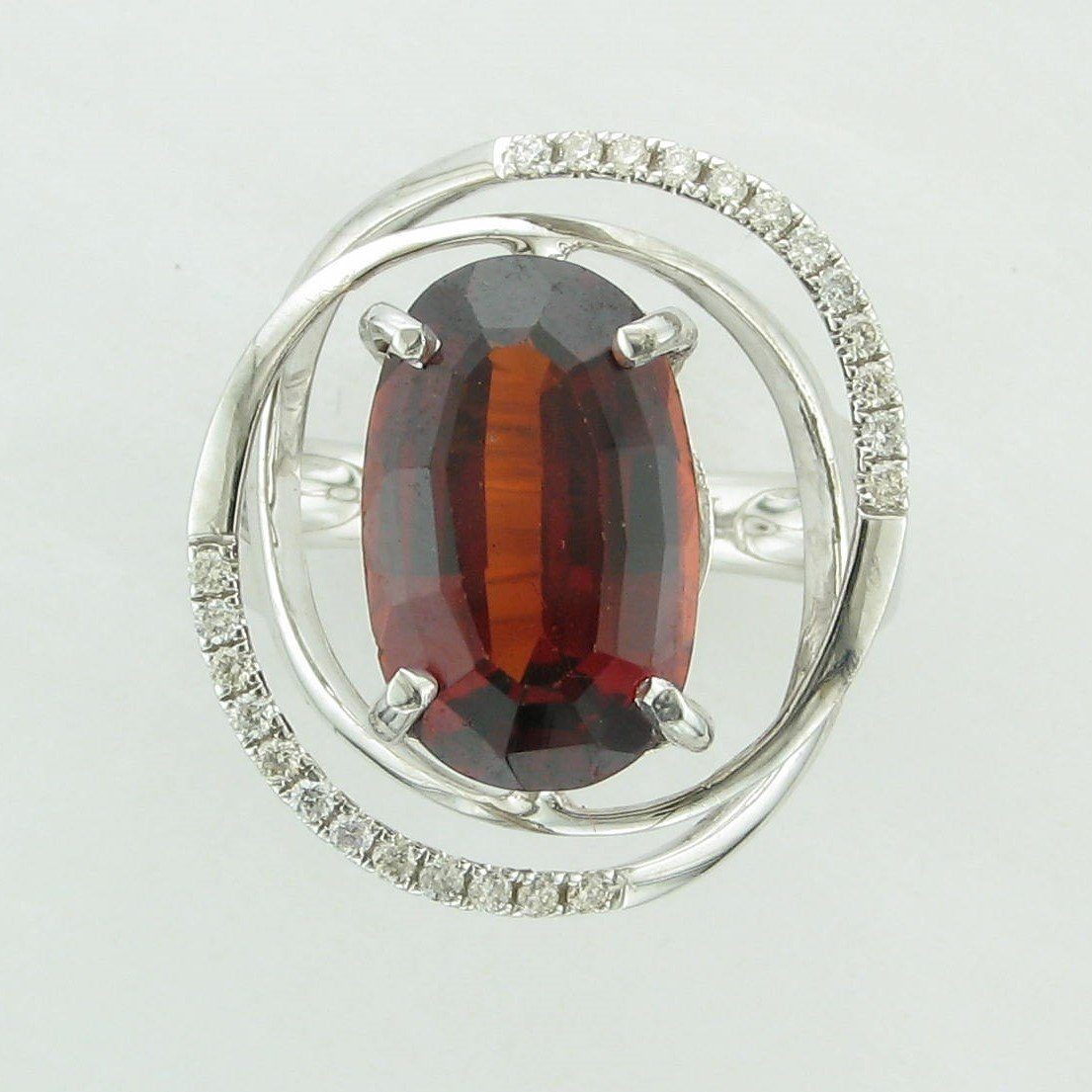 7.11ct Oval Mozambique Garnet Ring set in 14K White Gold