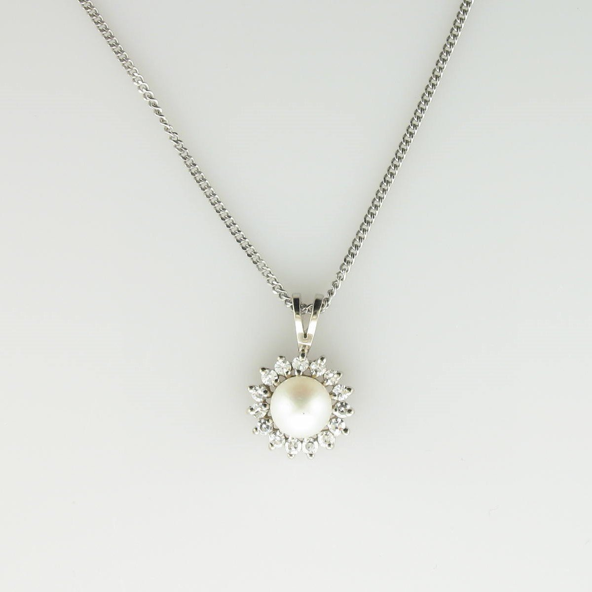7mm Pearl and Diamond Halo Necklace set in 14k White Gold