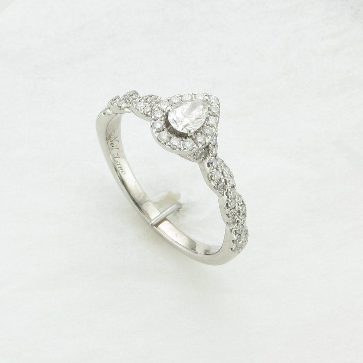 0.35ct Pear Diamond with Halo Ring set in 14K White Gold