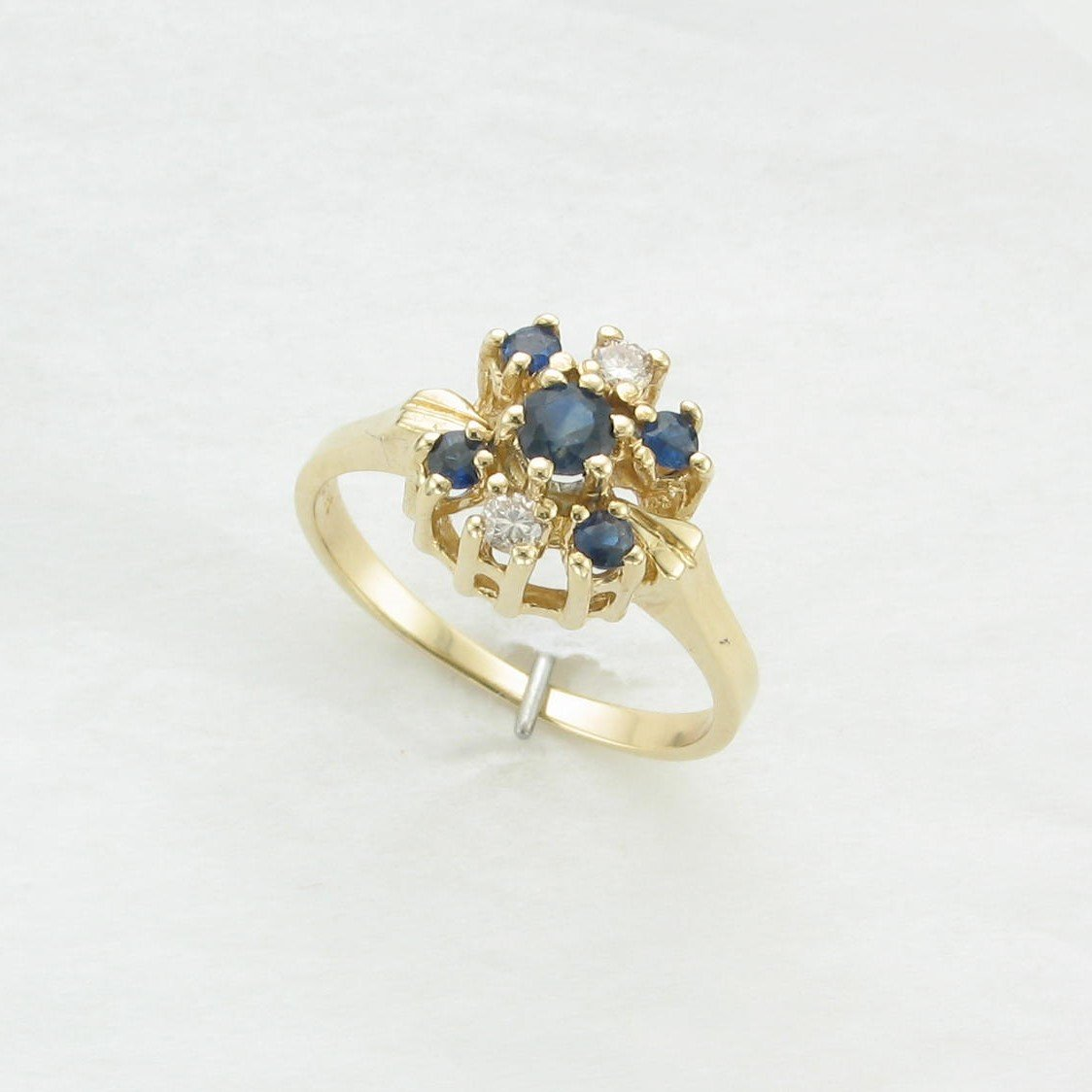 0.35 tcw Sapphire and Diamond Cluster Ring set in 14K Yellow Gold