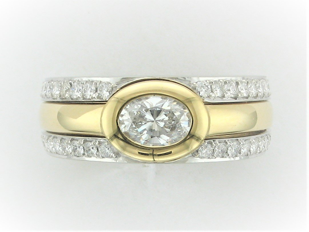 0.70 Total Carat  Weight Removable Oval East/West Bezel Set Diamond set in 18 Karat Yellow and White Gold Ring