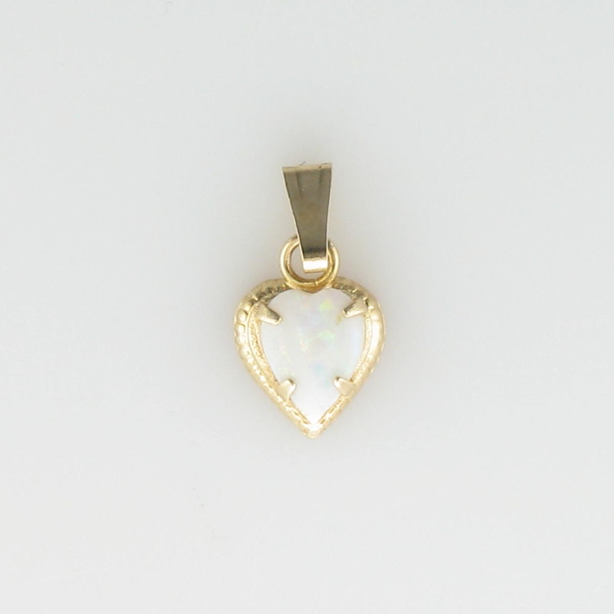 Heart Shaped Opal Pendant set in 14K Yellow Gold