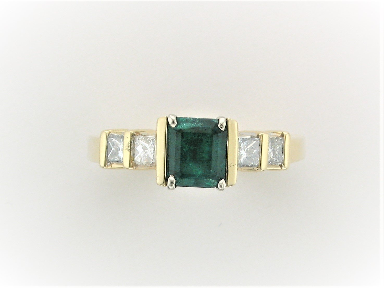 2.10 Total Carat Weight Custom Emerald and Diamond Ring in 14 Karat Yellow Gold