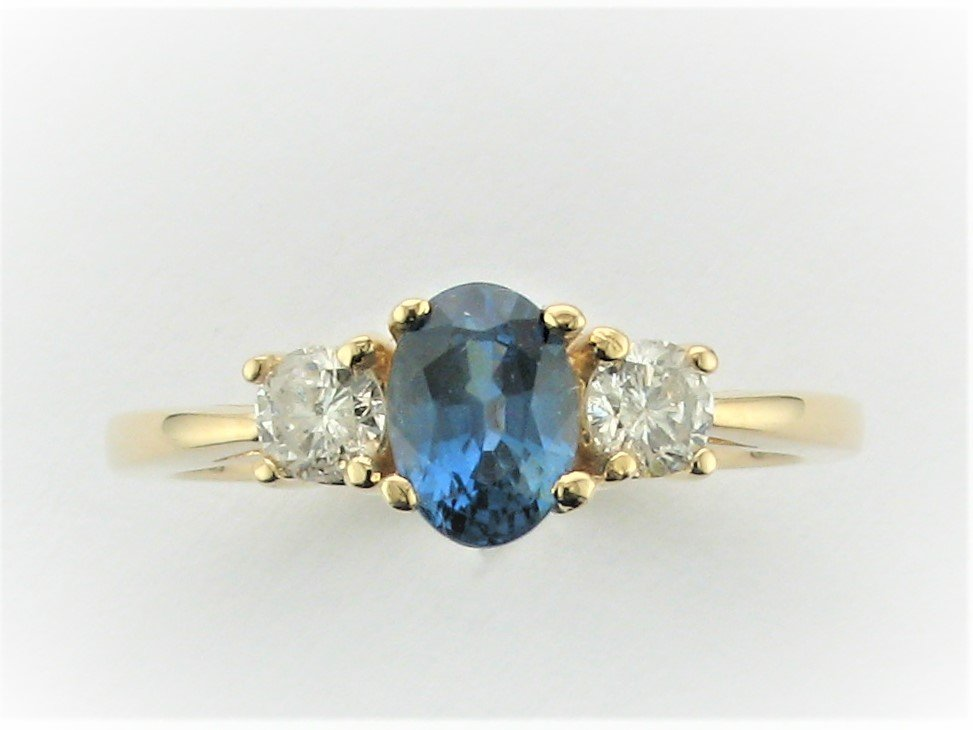 1.10 Carat Oval Montana Blue Sapphire and Diamond Ring Set in 14 Karat Yellow Gold