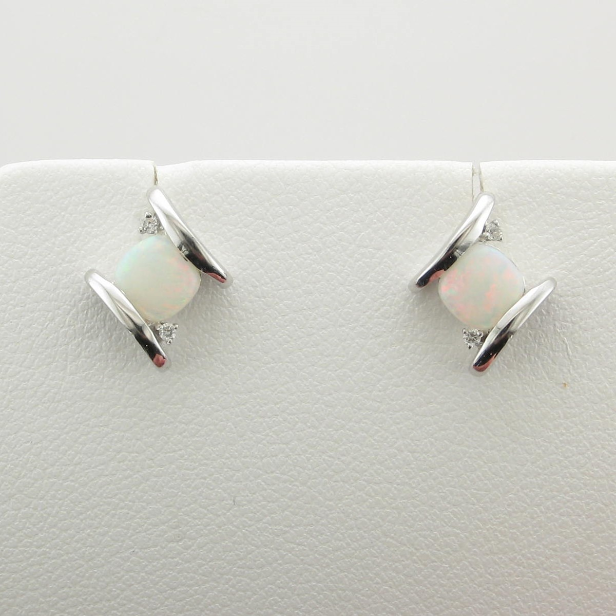0.56tcw White Opal Earrings set in 14k White Gold