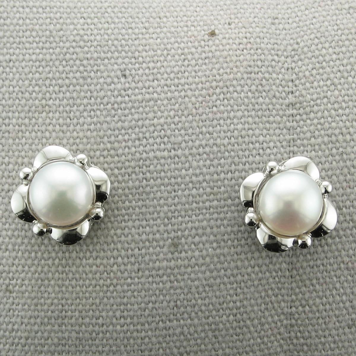 Pearl Earrings set in a Sterling Silver Flower