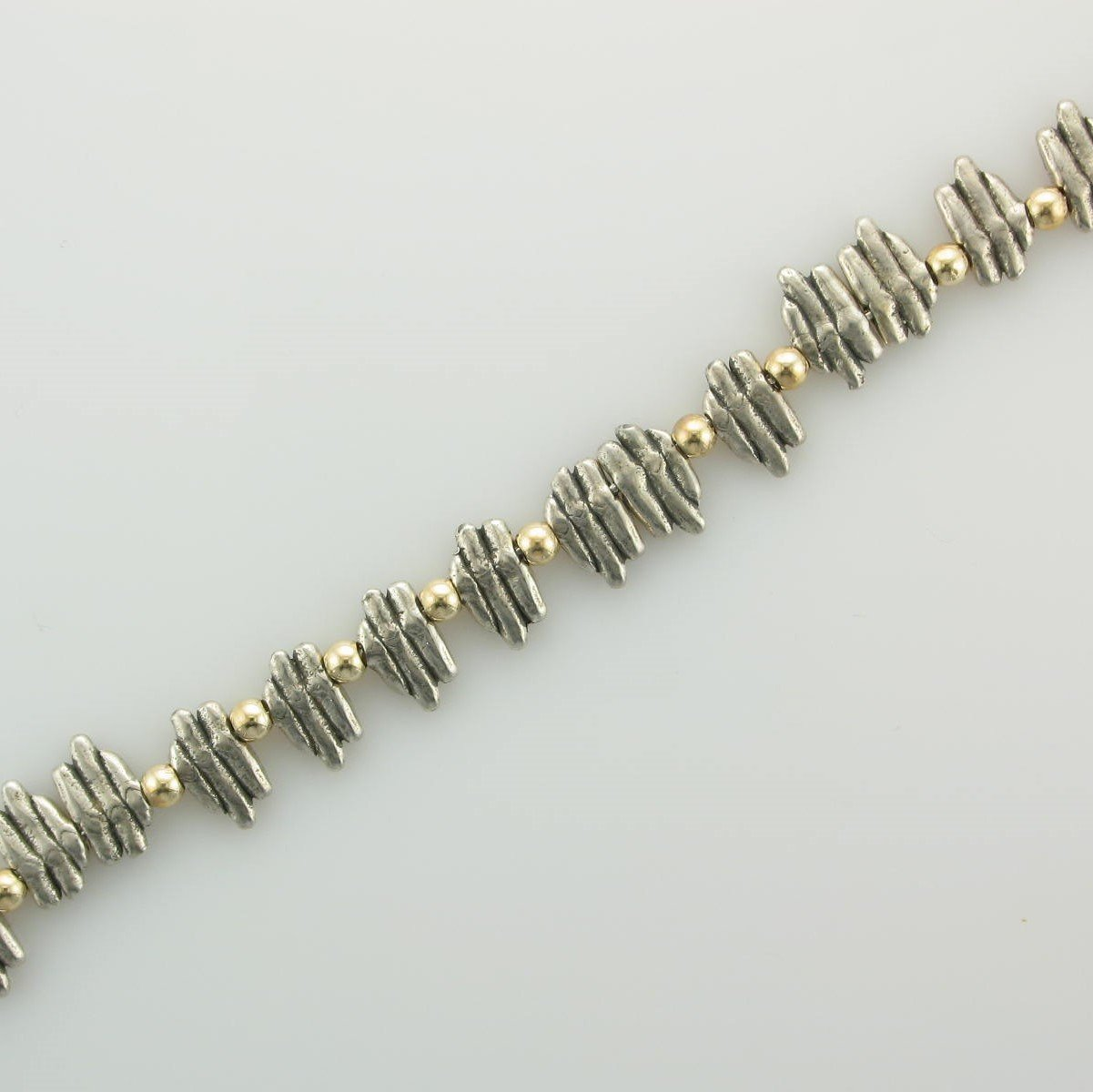 Sterling Silver Spike Beads and 14K Yellow Gold Beads Bracelet