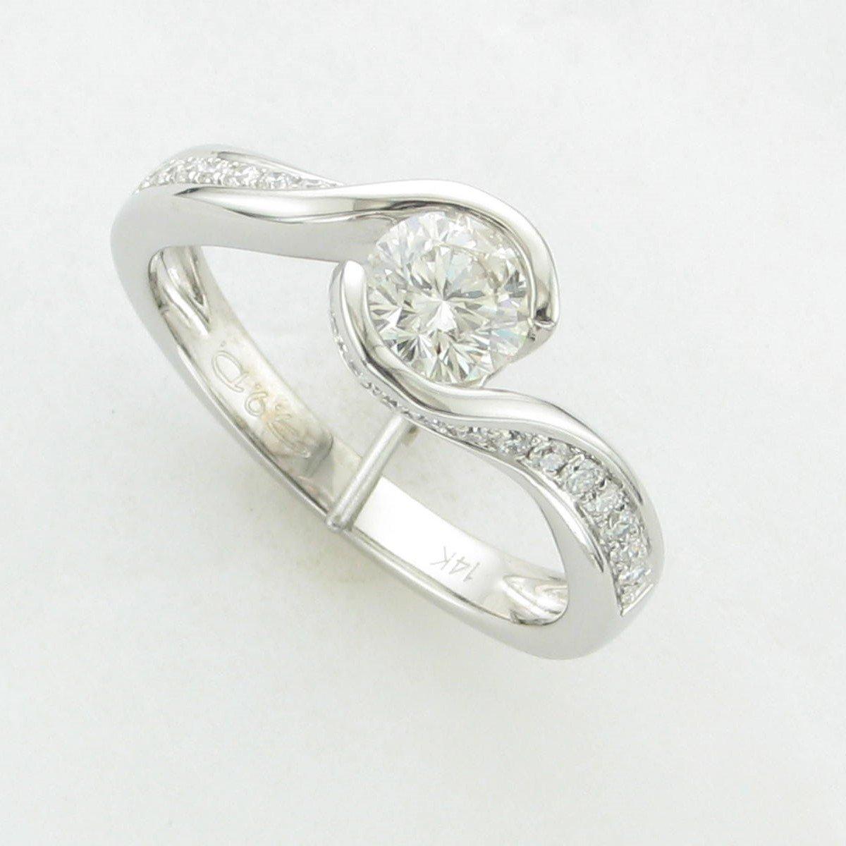 0.58ct. Round Diamond Ring set in 14K White Gold
