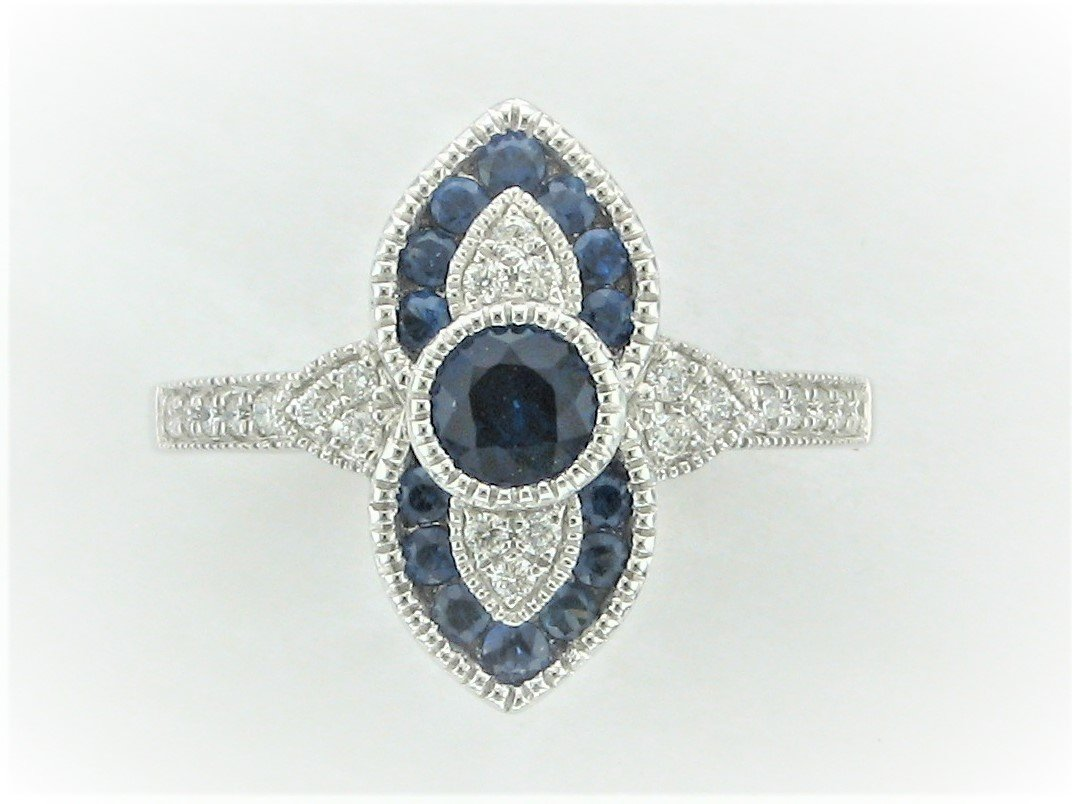 0.76 Carat Blue Sapphire and Diamond Ring set in 14 Karat White Gold