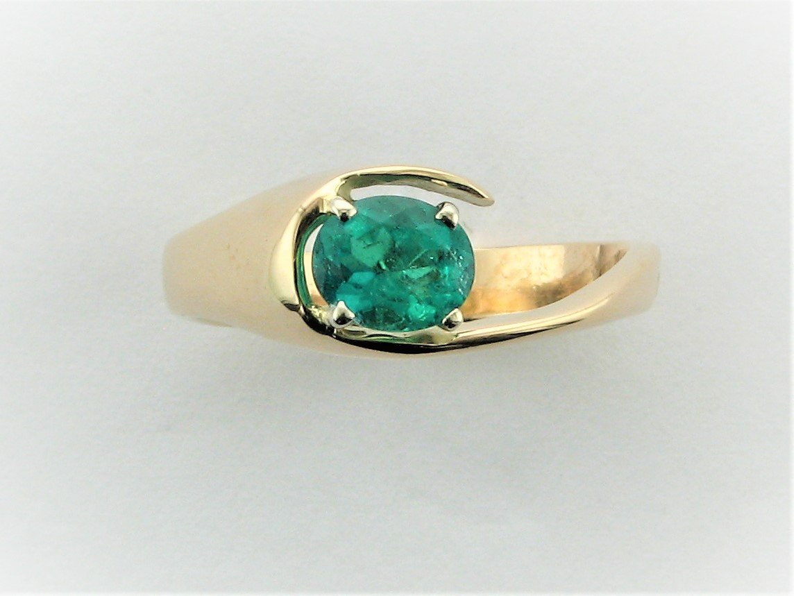 .65 Total Carat Weight Oval Emerald Ring in 14 Karat Yellow Gold