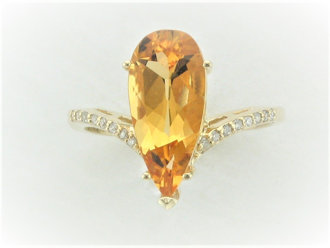 2.48 Total Carat Weight Elongated Pear Citrine and Diamond Ring set in 14 Karat Yellow Gold