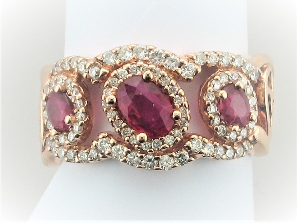 1.10 Carat Oval Ruby and .56 Carat Diamond Ring Set in 14 Karat Rose Gold