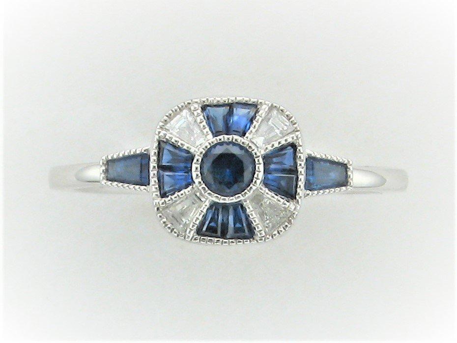 0.48 Carat Blue Sapphire & Diamond Ring Set in 14 Karat White Gold