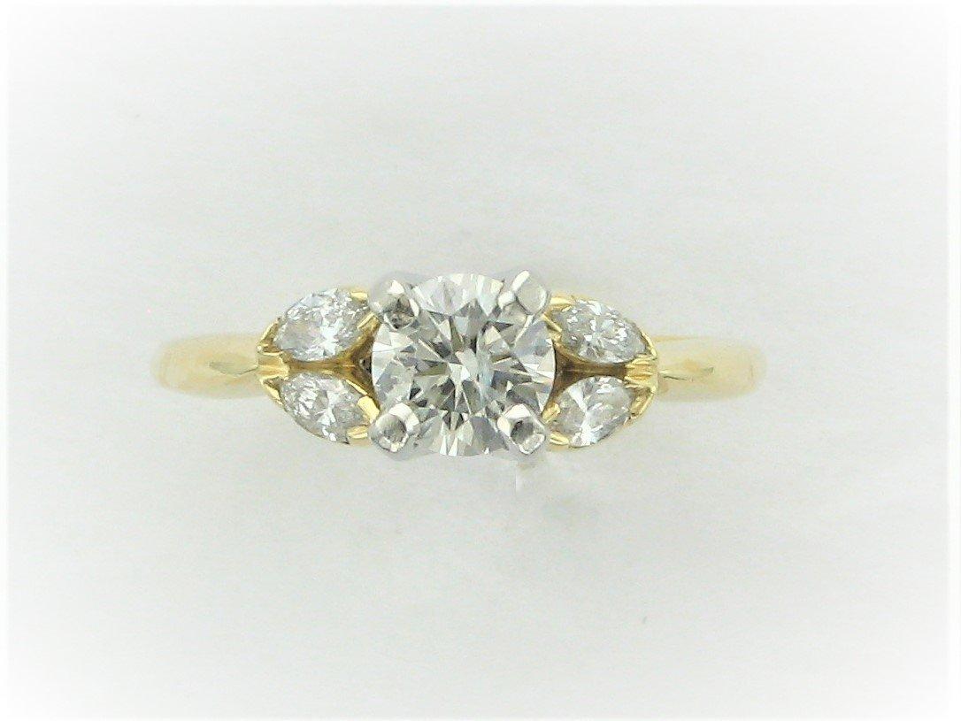 0.77 Total Carat Weight Diamond Ring Set in 18 Karat Yellow Gold