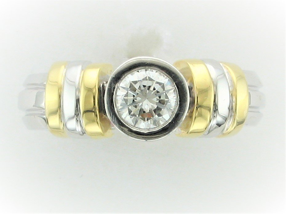 0.57 Total Carat Weight Round Bezel Set Diamond Ring set in Platinum and 14  Karat Yellow Gold