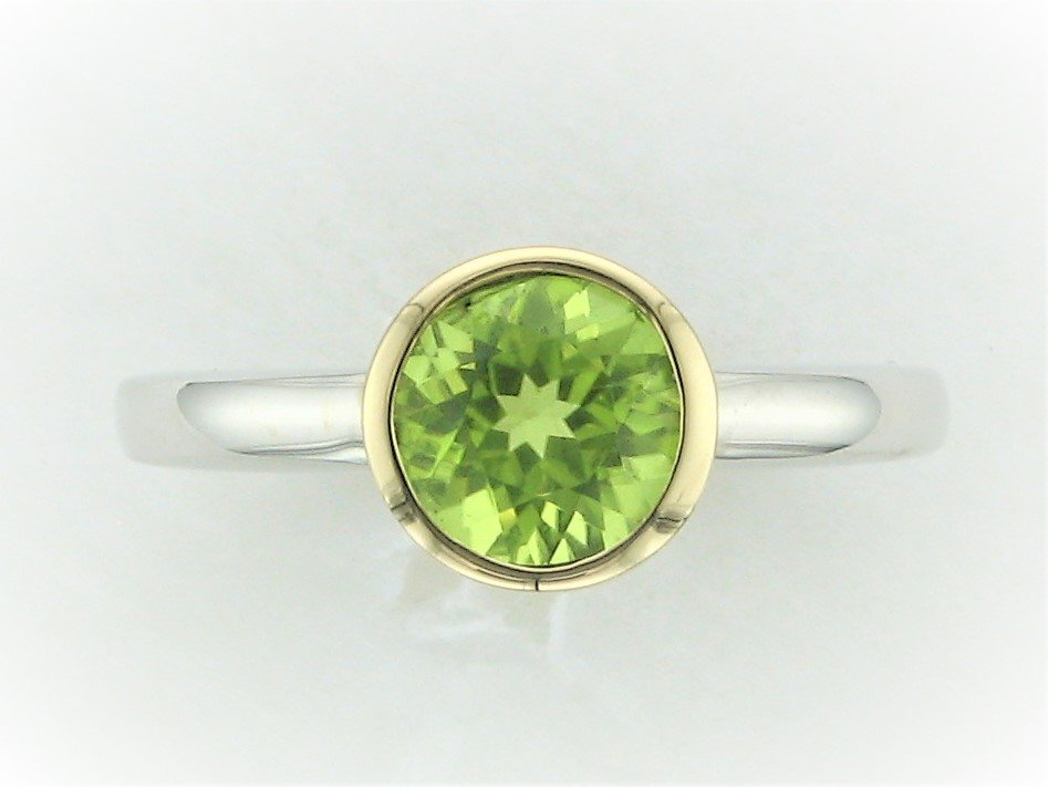 1.04 Total Carat Weight  Round Bezel Set Peridot Ring set in 14 Karat White and Yellow Gold